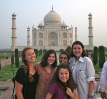 Photo of five students in front of the Taj Mahal